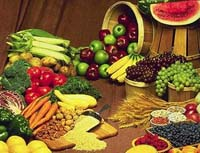 table full of fresh fruits and vegetables
